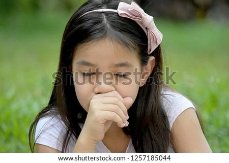 Sick Young Diverse Female Juvenile #1257185044