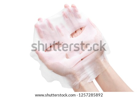 facial mask in wamon hand Royalty-Free Stock Photo #1257285892