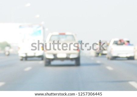 Blurred focus of traffic with many cars on the road in Thailand. People traveling out of town during long holidays weekend using low speed. Transportation, drive responsibly, media, billboard concept #1257306445