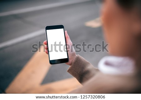 Using taxi service application on smart phone, blank screen. #1257320806