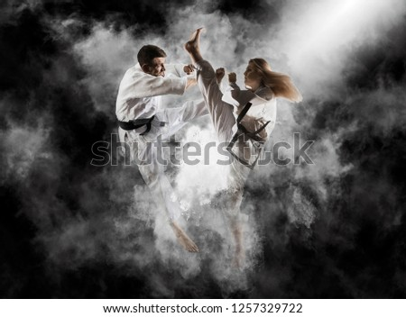 Martial arts masters, karate practice. Smoke background #1257329722