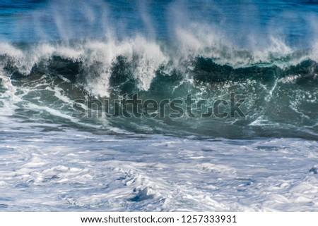 breaking wave in the Atlantic ocean Royalty-Free Stock Photo #1257333931
