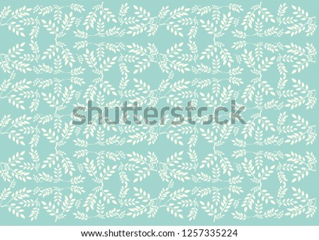 Turquoise backdrop with a light leafy pattern #1257335224
