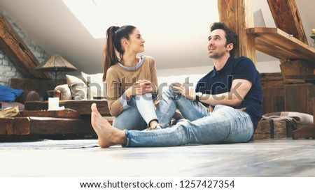 happy couple talking to each other at home #1257427354