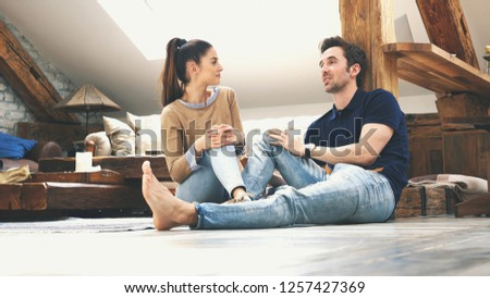 happy couple talking to each other at home #1257427369