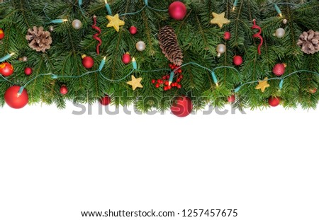 Christmas decorative background border with red bauble decorations, holly berries, spruce and pine cones #1257457675