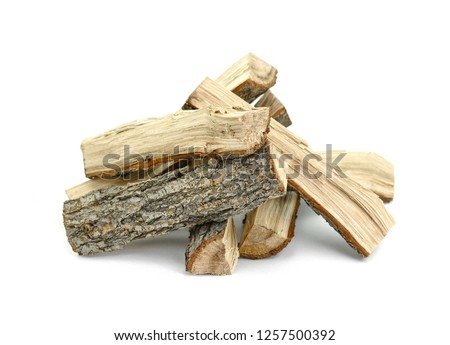 Firewood isolated on white. Oak Log Isolated on a white. Log fire wood isolated on white background with clipping path. Wooden obsolete log. #1257500392