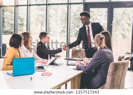 Business People Handshake Greeting Deal Concept. Young African American businessmen shaking hands during contract signing at workplace #1257517243