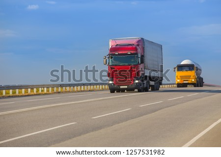 trucks goes on highway in evening on sunset #1257531982