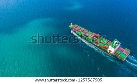 Container ship carrying container for import and export, Aerial view business logistic and freight transportation by container ship in open sea. #1257567505