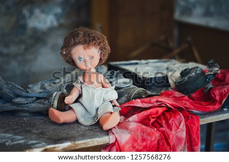 Broken doll during evacuation after Chernobyl catastrophe from Pripyat #1257568276