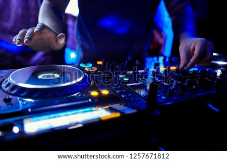 Dj mixes the track in the nightclub at party #1257671812