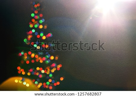 Bokeh silhouette of Christmas tree.blur light celebration on christmas tree on dark wall background. Abstract Christmas tree lights.Winter holidays greeting card.fairy lights.Copy space