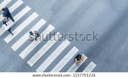 From the top view of people walk on street pedestrian crossroad in the city street with the motorcycle drives pass road ,bird eye view. #1257701236