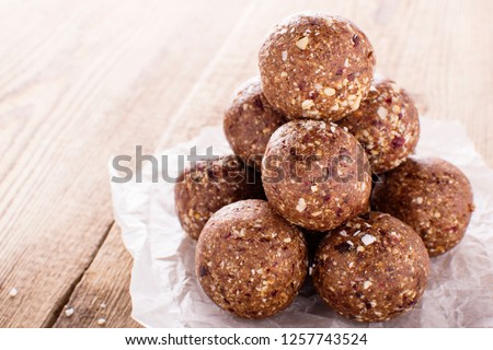 nutty chocolate energy balls on parchment paper Royalty-Free Stock Photo #1257743524