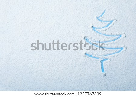 Christmas tree silhouette in snow on color background, top view with space for text