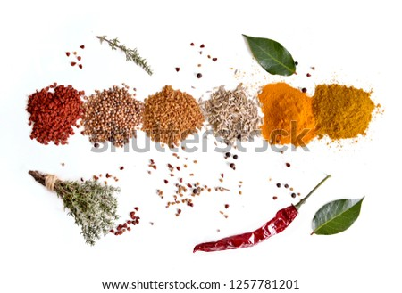top view on heaps of indian powder spices with thyme and pepper on white background #1257781201