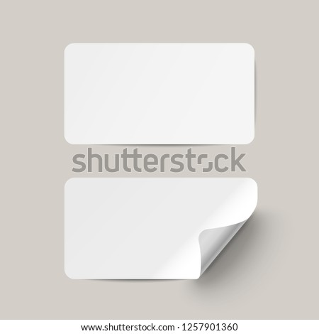 Vector white realistic paper adhesive stickers with curved corner on transparent background. #1257901360