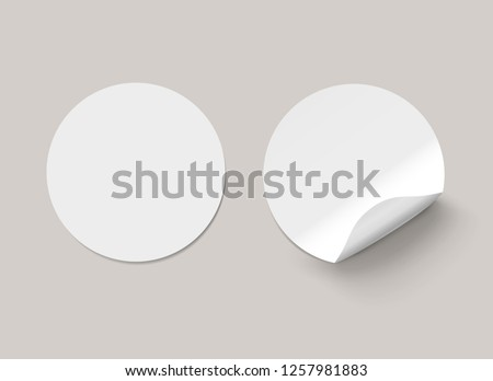 Vector white realistic round paper adhesive stickers with curved corner on transparent background. #1257981883