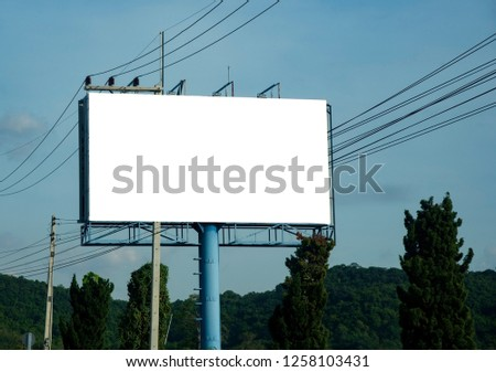 Blank billboard on blue sky background for new advertisement #1258103431