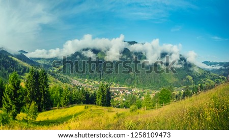 Majestic view on beautiful fog mountains in mist landscape. Dramatic unusual scene. Travel background. Exploring beauty world. Carpathian mountains. Ukraine. Europe. #1258109473