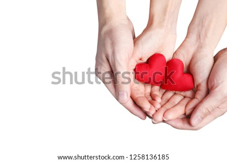 Male and female hands holding two red love hearts, isolated on white background #1258136185