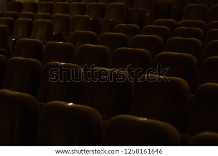 red velvet seats for spectators in the theater or cinema #1258161646