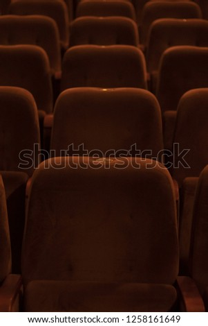 red velvet seats for spectators in the theater or cinema #1258161649