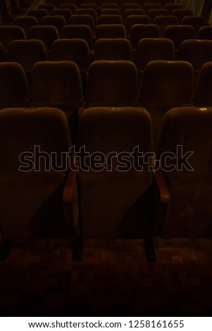 red velvet seats for spectators in the theater or cinema #1258161655