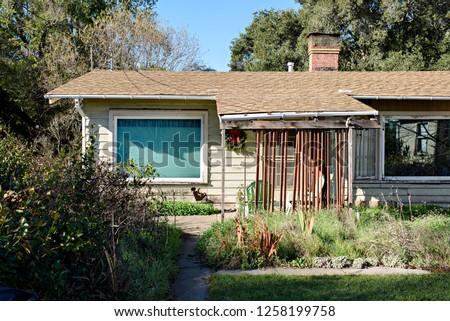 Old, Rundown House in the Neighborhood #1258199758