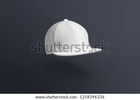Blank cap in perspective view. White snapback on dark background. Blank baseball snap back cap for your design. Mock up hat cap for you logo, brand identity etc.  #1258396336