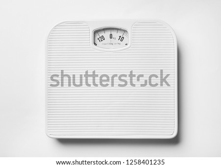 Bathroom scales on white background, top view. Weight loss concept #1258401235