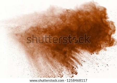 Brown powder explosion on white background. Paint Holi. #1258468117