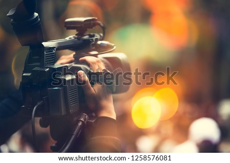 Video camera operator working with his equipment #1258576081