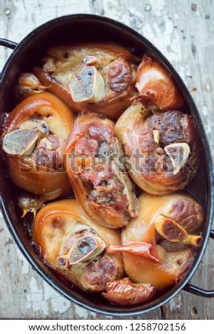 Pork hogs baked in beer  #1258702156