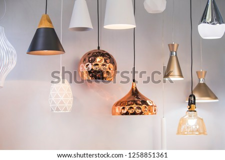 Different modern streamlined mirror copper chandeliers. Bubble metal copper shade pendant. #1258851361