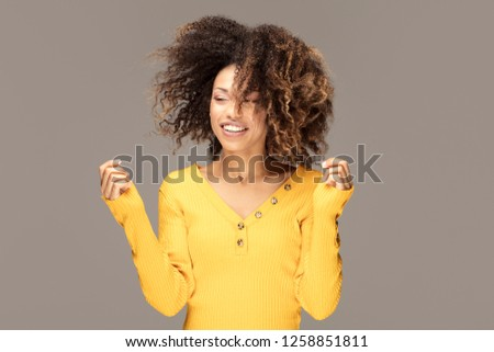 Happy african american woman smiling. Beautiful female half-length portrait. Young emotional afro woman. The human emotions, facial expression concept. #1258851811
