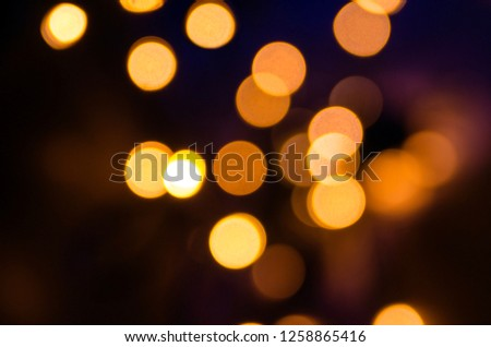 Bokeh golden lights in the night.Glamour celebration holiday background #1258865416