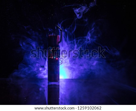 Image of a time bomb against dark background. Timer counting down to detonation illuminated in a shaft light shining through the darkness, conceptual image #1259102062