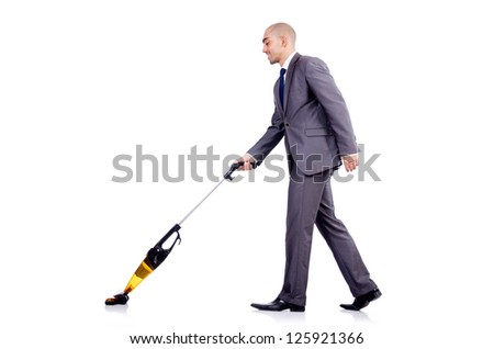 Businessman doing vacuum cleaning on white #125921366