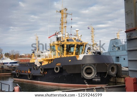 Tugboats and other marine support vessels in port. #1259246599