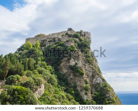 Aerial view of iconic medieval fortified castle of Angelokastro with amazing views, known as Angel Castle close to Paleokastritsa, summer cloudy day, Corfu Greece #1259370688