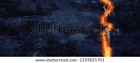 low key banner of silver sword in the flames of fire. fantasy medieval period