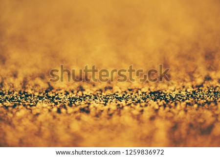 Blur neon gold light circle background. Sparkling firework bokeh dots in retro film style. Luxury and classy new year and christmas celebration party textured backdrop. Blurry golden dust particles.