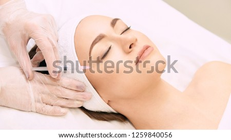 Anti wrinkle surgery. Beauty young woman injection. Facial treatment. #1259840056