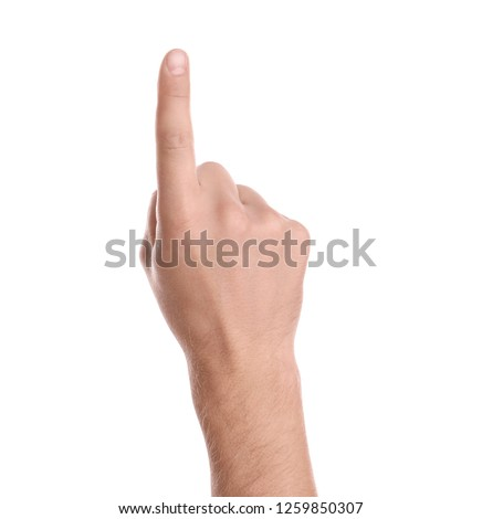 Man pointing at something on white background, closeup of hand Royalty-Free Stock Photo #1259850307