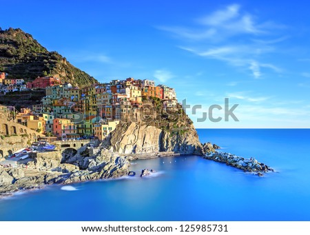 Manarola village on cliff rocks and sea at sunset., Seascape in Five lands, Cinque Terre National Park, Liguria Italy Europe. Long Exposure Photography. #125985731