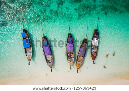 amazing Thailand hi season boats and tourists international on phi-phi island Krabi Thailand aerial view from drone camera #1259863423