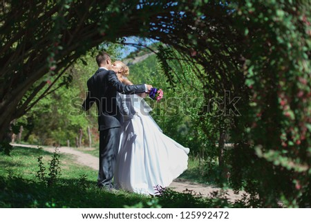 Beautiful bride and groom walk in the spring forest #125992472