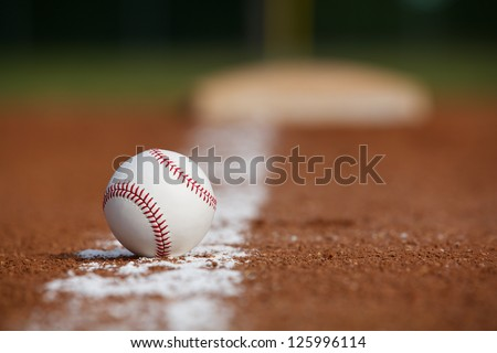 Baseball on the Infield Chalk Line with the Base in the distance